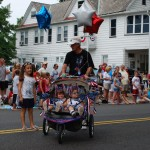 The perambulators may have changed, but the delight to see a child in this parade remains the same.