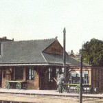 Postcard detail: Riverton's second railroad station opened 1887, replacing the first one that once stood on the lot now occupied by the Riverton War Memorial. Note Roberts Store, built 1891 on point. View is toward the river at Broad & Main.